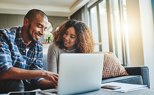 Couple in front of computer smiling