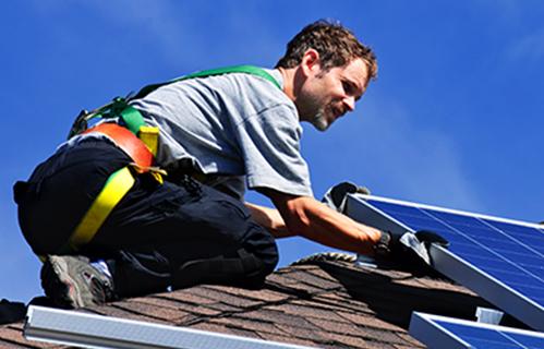 Installer placing a solar panel